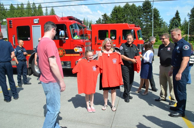 Kylie Morgan (left) and Brenda Welch (right) show off new T-shirts from Lynnwood Fire.