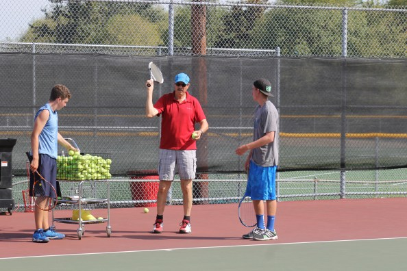 Mountlake Terrace Hawks Tennis Coach Alberto Ramirez (center) has had to actively recruit at the school and down at Brier Terrace Middle School in order to insure he has enough tennis players each season to fill his varsity and junior varsity rosters.