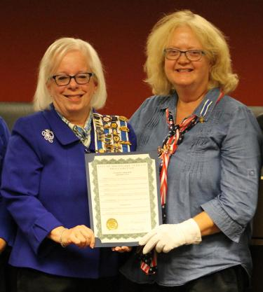 Sally Buckingham (left) and Judy Lehman, local chapter members of the National Society Daughters of the American Revolution, hold the proclamation that authorizes September 17-23 as Constitution Week in Mountlake Terrace.