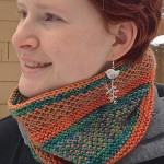 Andy in the Slippy Cowl. Pattern free with any 2 skein order of ModeLuxe.
