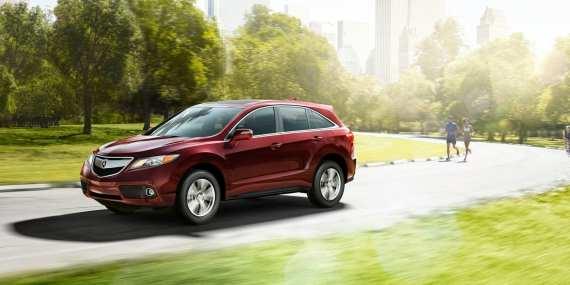 2013-rdx-exterior-with-technology-package-in-basque-red-pearl-ii-park-and-buildings-10