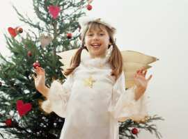 Smiling Young Girl Dressed as an Angel