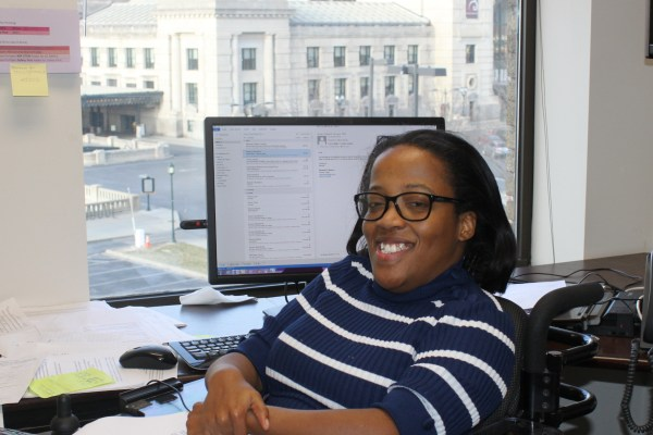 Pictured: Laura works at her desk overlooking Union Station.