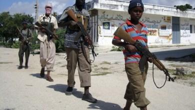 A boy leads other Somali Islamist militia as they patrol the streets of Somalia's capital Mogadishu