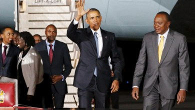 U.S. President Barack Obama waves to reporters as Kenya's President Uhuru Kenyatta (R) looks on, after Obama arrived aboard Air Force One at Jomo Kenyatta International Airport in Nairobi July 24, 2015. U.S. President Barack Obama flew into Kenya late on Friday for his first presidential visit to his father's homeland, aiming to boost trade and security ties. REUTERS/Jonathan Ernst