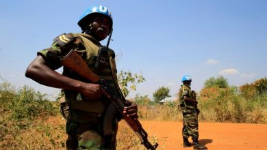 UNAMIS personnel guard South Sudanese people displaced by recent fighting in Jabel