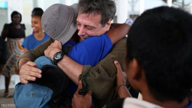 Some of the 26 Asian sailors released after being held captives by Somalia pirates for more than four years become emotional as they greet Michael Scott Moore (C), a former hostage who said that he was involved in helping with their release, as they arrive at the Jomo Kenyatta International airport in the capital Nairobi, Kenya, October 23, 2016. REUTERS/Siegfried Modola