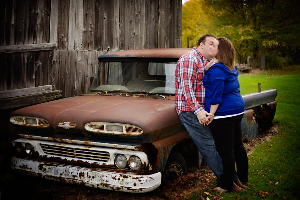 Cornwall engagement session - man in plaid shirt kissing girlfriend