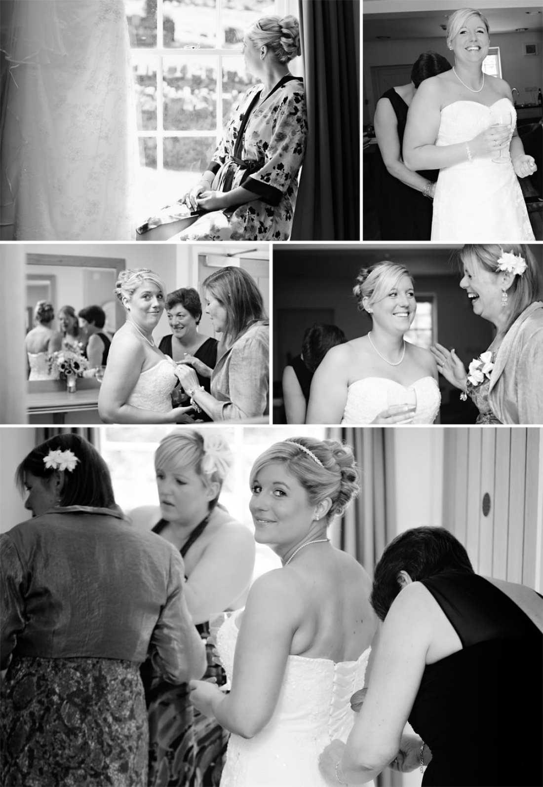 North Wales wedding - bride getting into dress