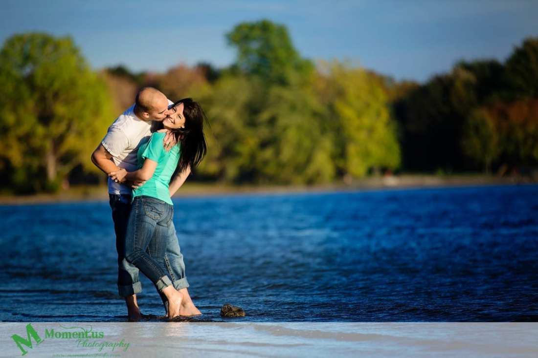 Cornwall engagement photographer - woman in green shirt in water