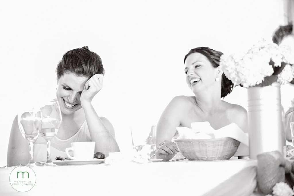 bride and sister laughing during speeches