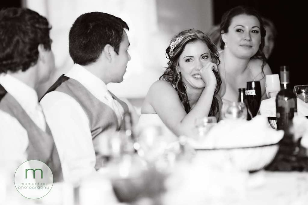 bride touching face while crying