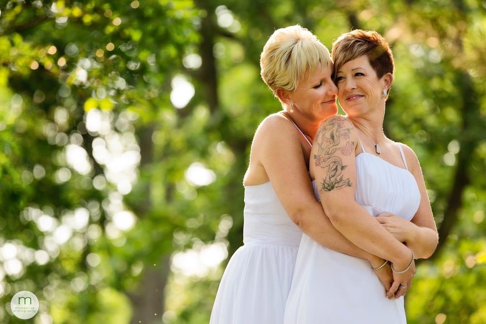 brides cuddling in trees
