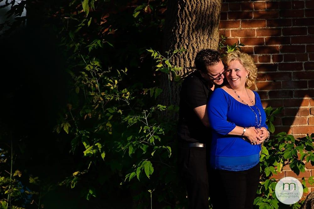 man hugging woman in blue shirt