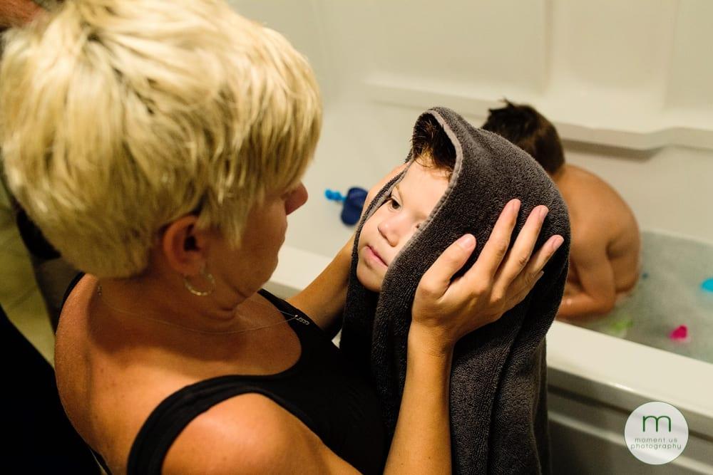 mom looking at boy in towel