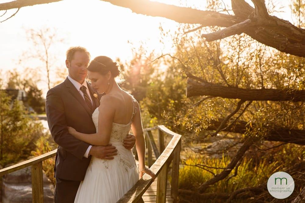 bride and groom on wooden boardwalk