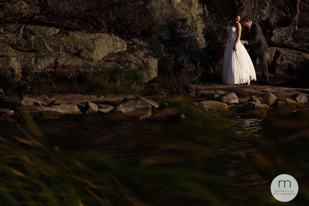 groom bustling bride's dress