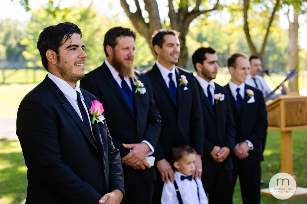 groom and groomsmen looking at bride during Maxville Fairground wedding