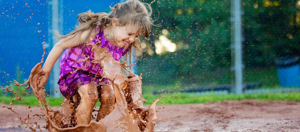Cornwall girl jumping in puddle
