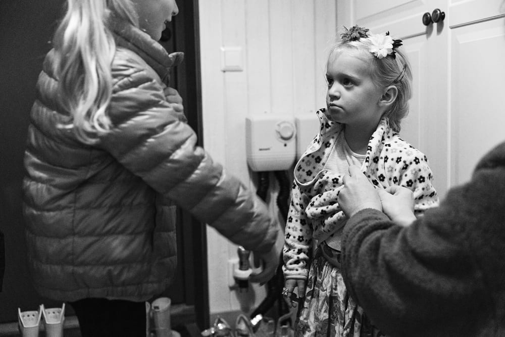 Stockholm girl getting coat zipped