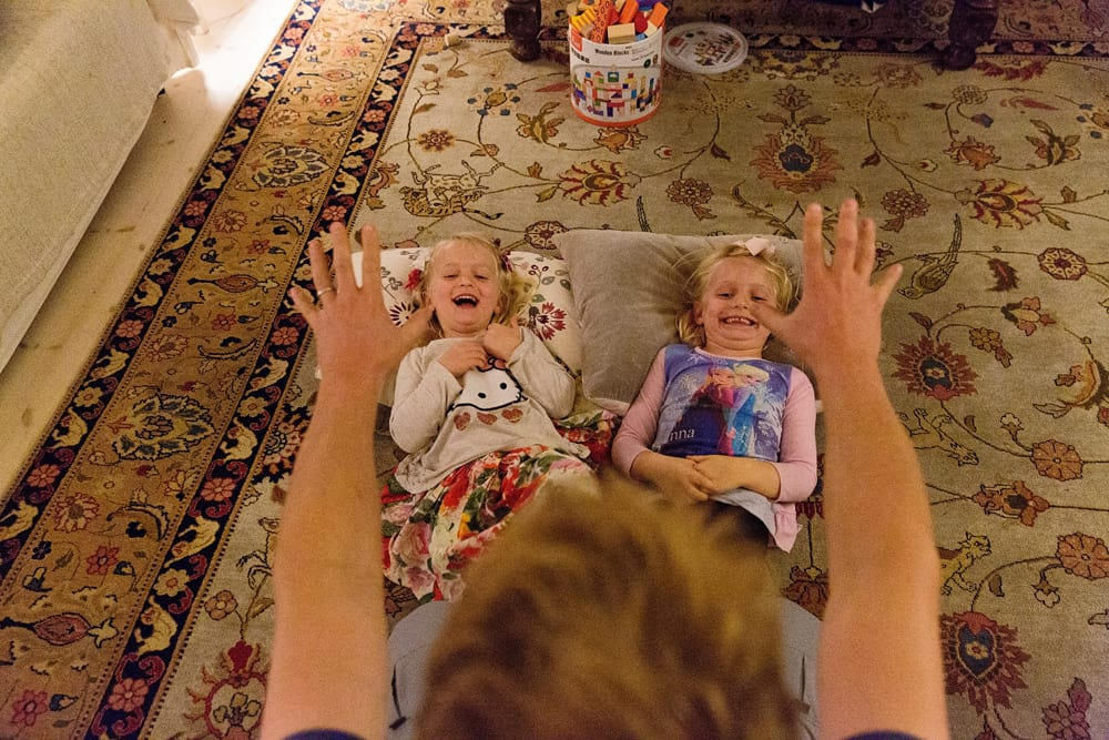 Stockholm family playing tickle game
