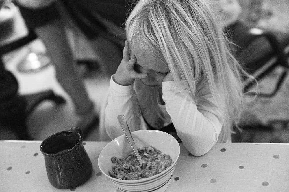 Stockholm girl crying over cereal