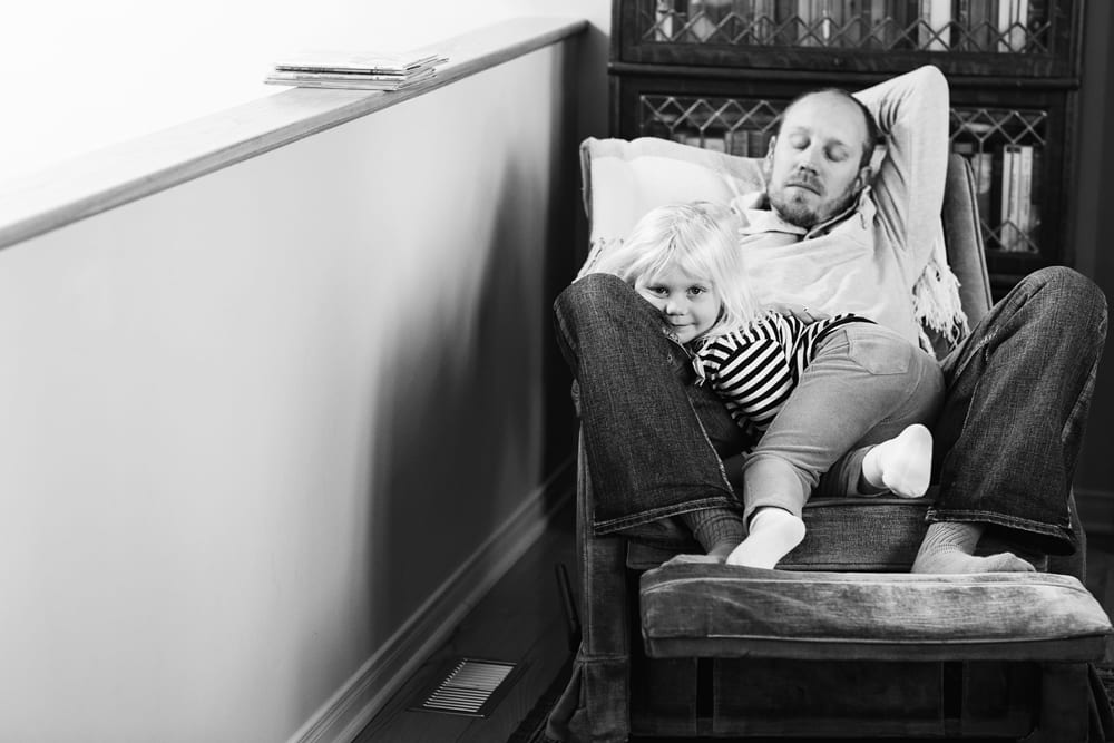 Cornwall family photographer - daughter with dad after reading
