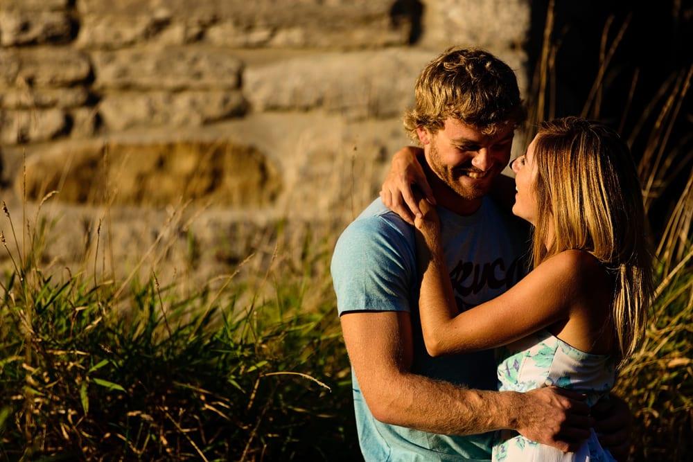 Ontario wedding photographer - couple cuddling for Cornwall engagement photos along the Raisin River