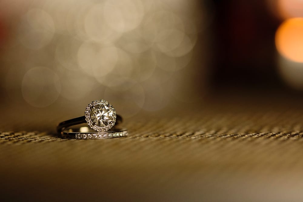 wedding rings on burlap in backyard wedding