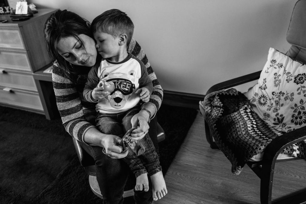 boy snuggling mom during South Wales family photo session