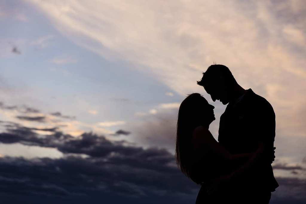 silhouette of couple at sunset during Cornwall engagement session