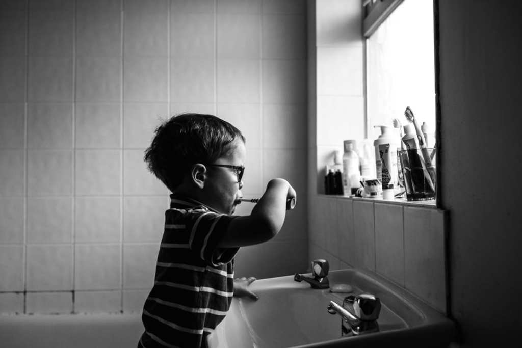 boy brushing teeth during London family photography session