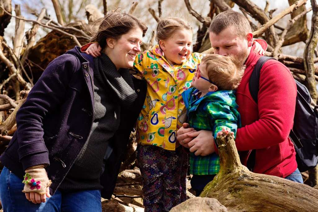 Family playing on logs during London family photography session