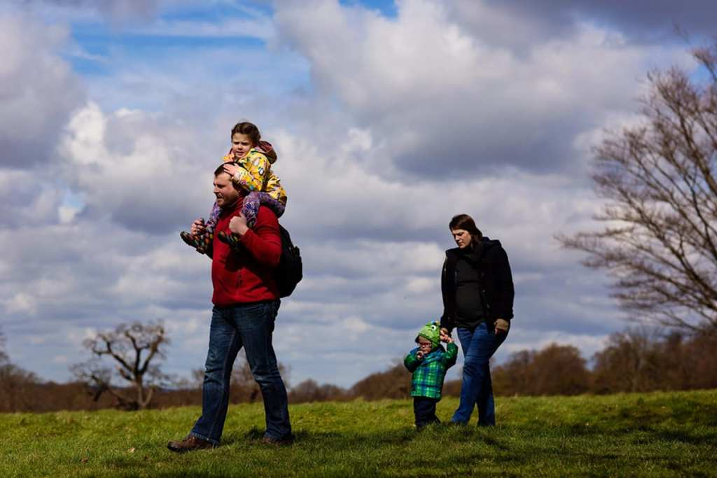 Family walking through Richmond Park during London family photography session