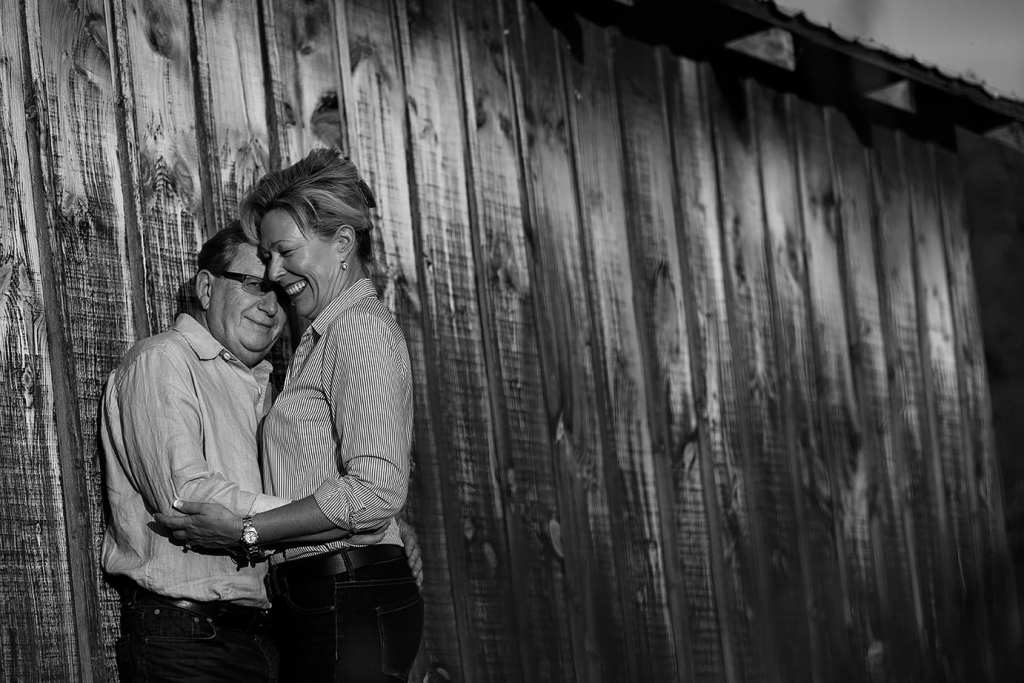couple against shed wall for Williamstown engagement session