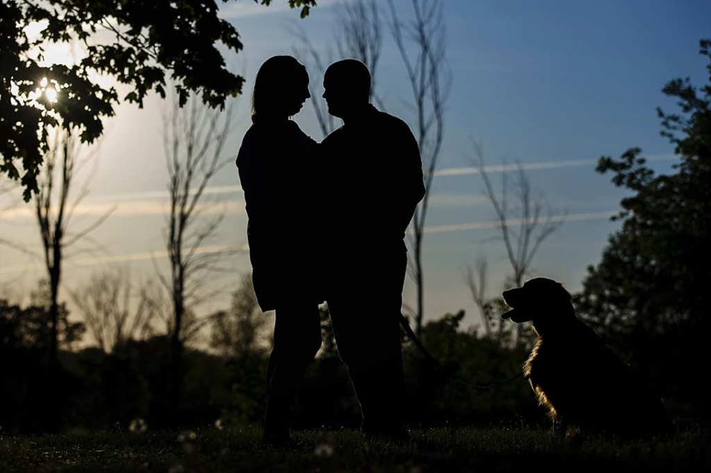 Silhouette with dog at the ruins during St Raphael's engagement session