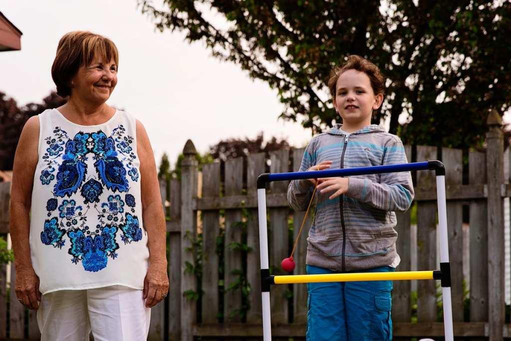 boy playing summer yard games with grandma