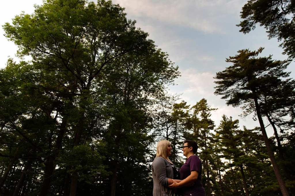 LGBT couple engagement in woods