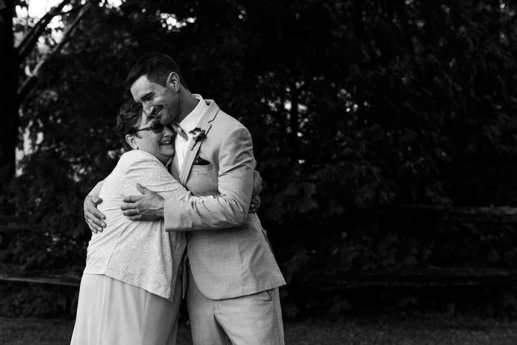 Groom hugging mother at intimate Strathmere wedding
