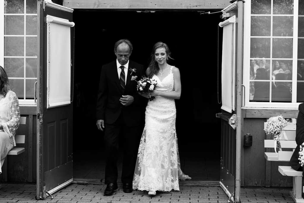 Bride being escorted by her father down the aisle