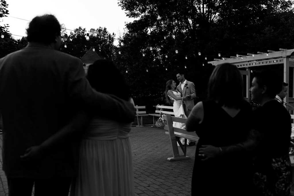 Bride and groom's first dance on outdoor patio at intimate Strathmere wedding
