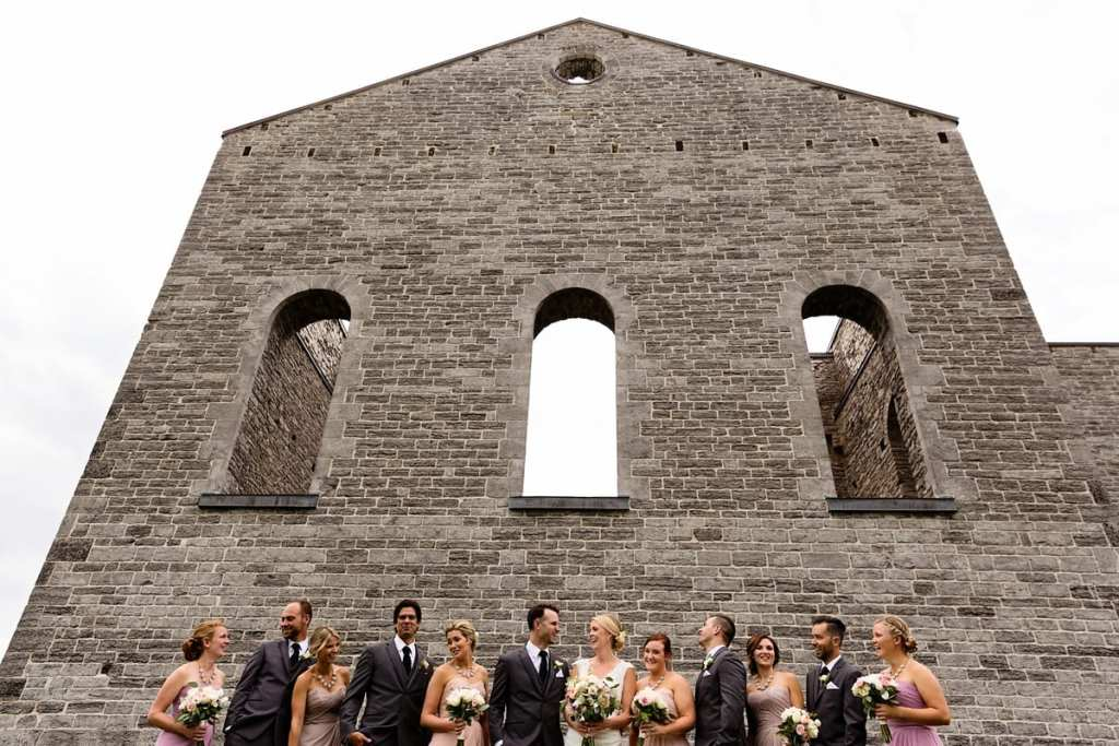 Wedding party group shot against church ruins in rural ontario wedding