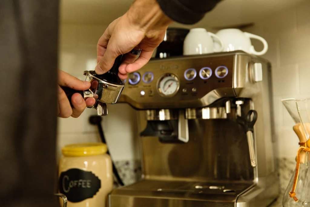 Man making coffee in modern Cornwall loft condo