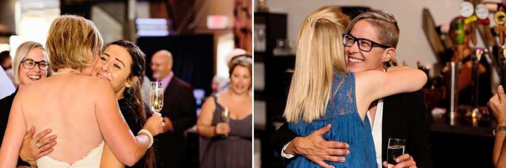 guests congratulating brides at chic lesbian cornwall wedding