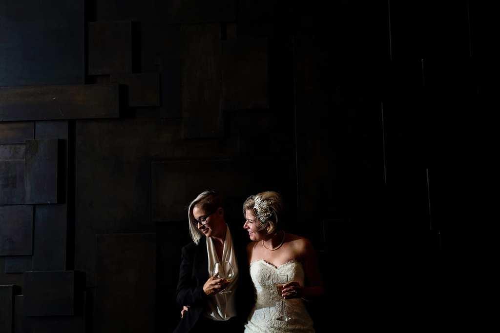 LGBTQ wedding brides on unique geometric black background