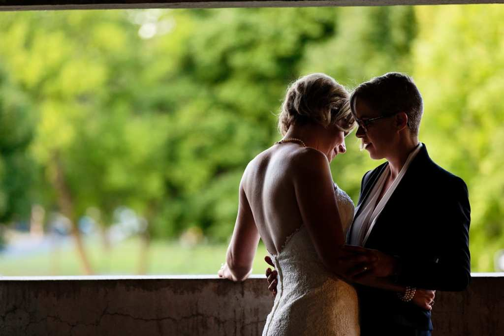 brides romantic embrace in same-sex Cornwall wedding