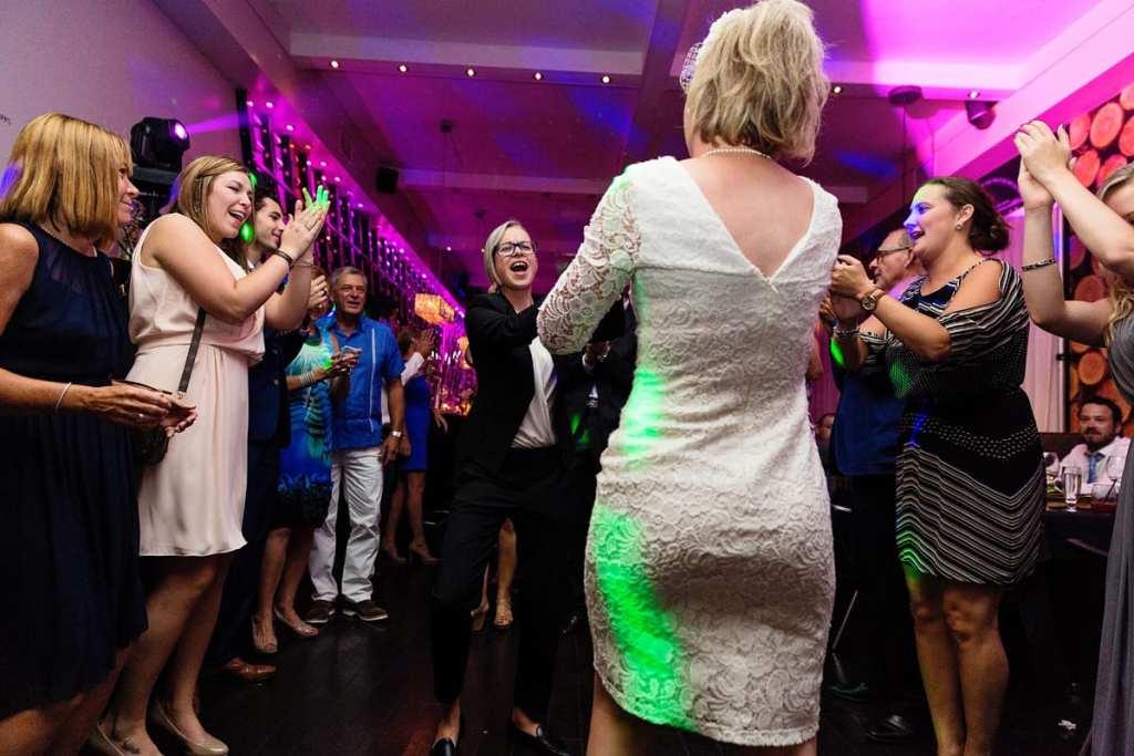 brides dancing at same-sex wedding chic reception