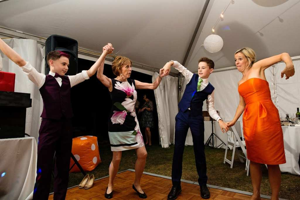 reception guests and teens dancing at intimate Calabogie wedding reception