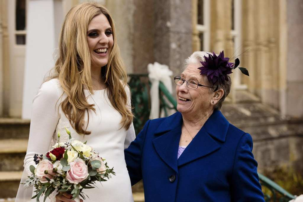 Bride with grandmother after Highcliffe Castle wedding ceremony
