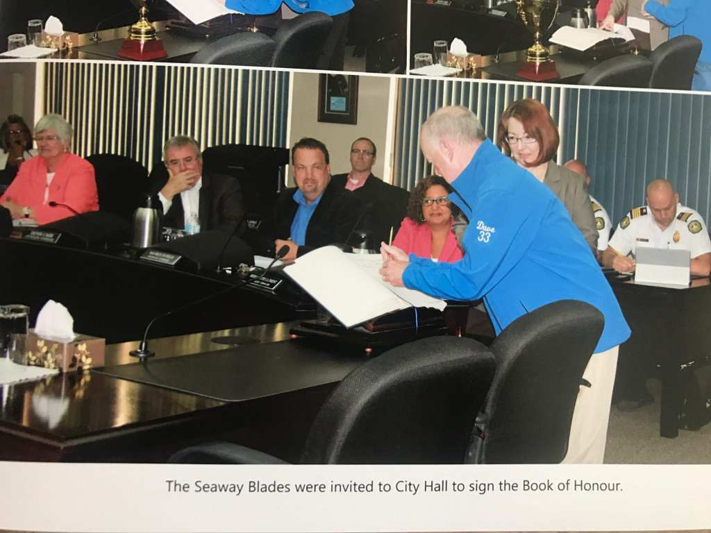 Cornwall family photographs - man signing book at City Hall